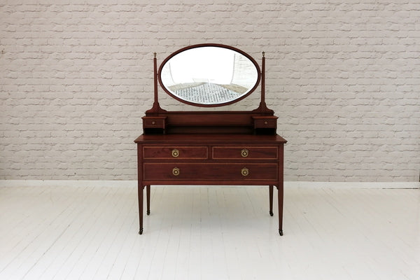 An Edwardian inlaid dressing table with swing mirror