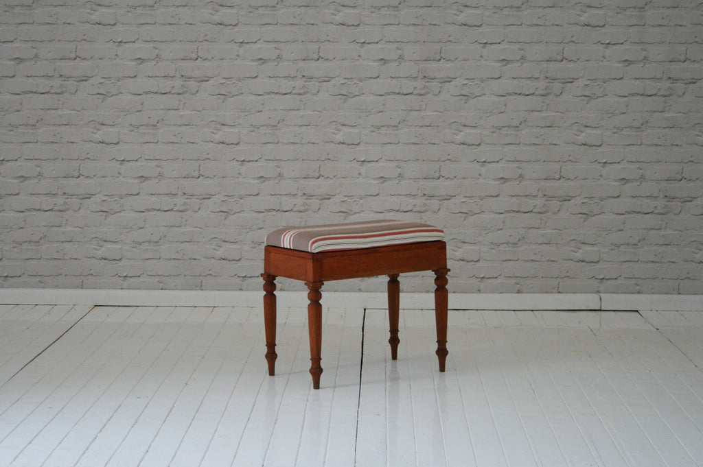 A Victorian commode chair converted into a stool