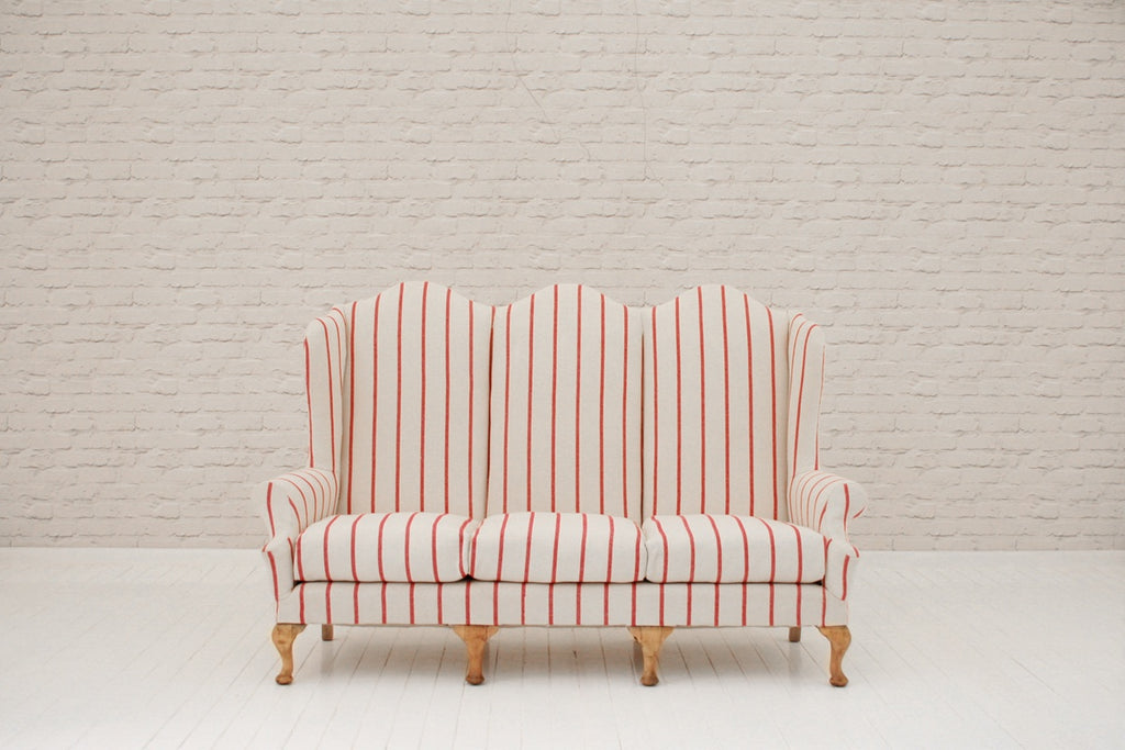 A Victorian camel back sofa in Foy & Co striped cotton