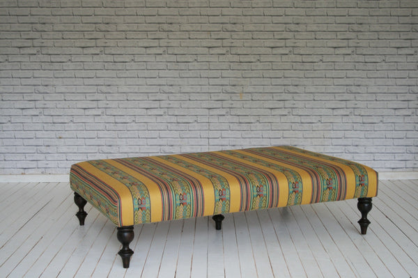 A large ottoman / coffee table upholstered in stunning Turkish cotton