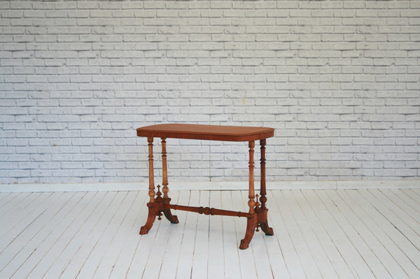 A Victorian mahogany side table with beautifully turned leg detail and central stretcher