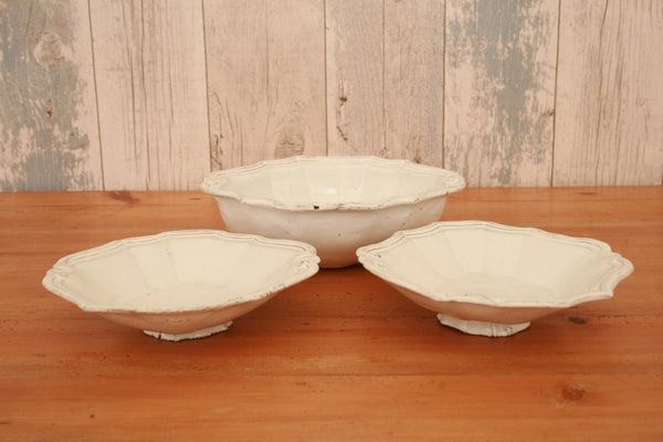 A set of white handmade ceramic French small serving bowls