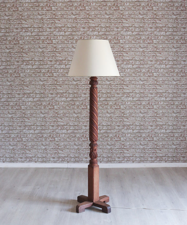 A beautifully carved mahogany standing lamp