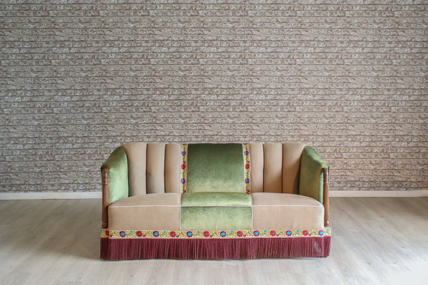 A 1930's Danish sofa in oatmeal linen, green velvet with antique silk & cotton embroidered border detail