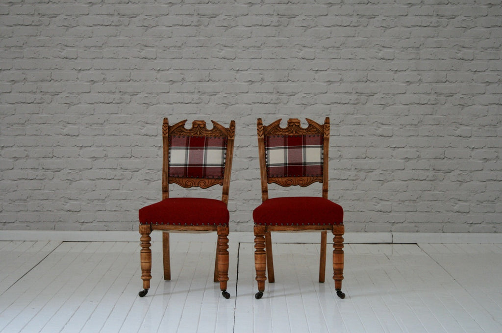 A pair of carved oak Victorain dining chairs with  herringbone wool upholstery