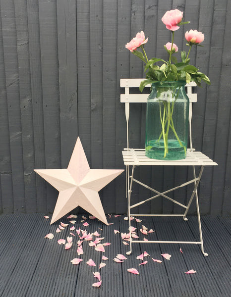 Hand painted in a delicate blush pink & finished, each star hints at its rustic past.