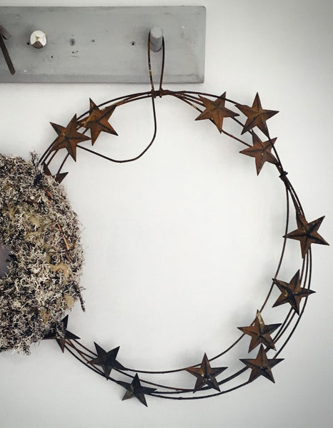 Rusty metal star wreath wall hanging