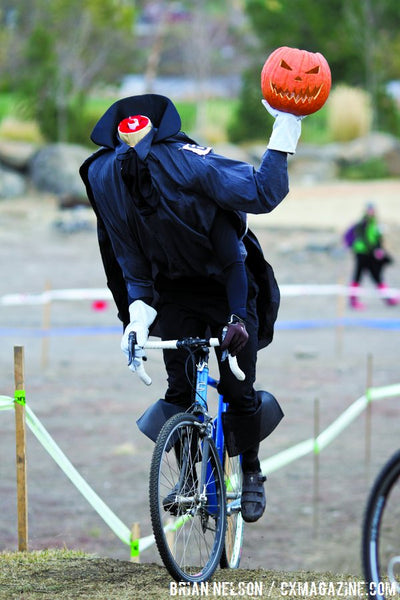 Headless costume on bike. Headless horseman