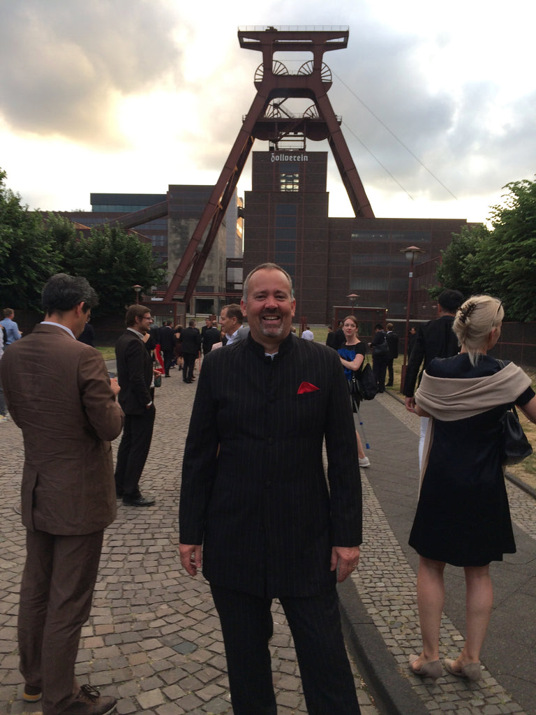 Neil standing outside the Red Dot Design Museum - former site of the Zollverein Coal Mine