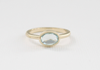Oval Aquamarine Bezel Ring in 14K Yellow Gold