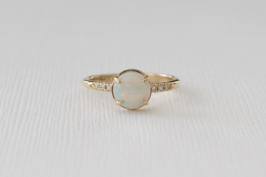 Opal Solitaire Ring in 14K Yellow Gold