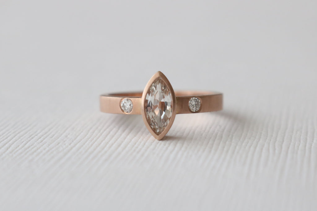 Marquise Cut White Sapphire Bezel Ring in 14K Matte Finish Rose Gold