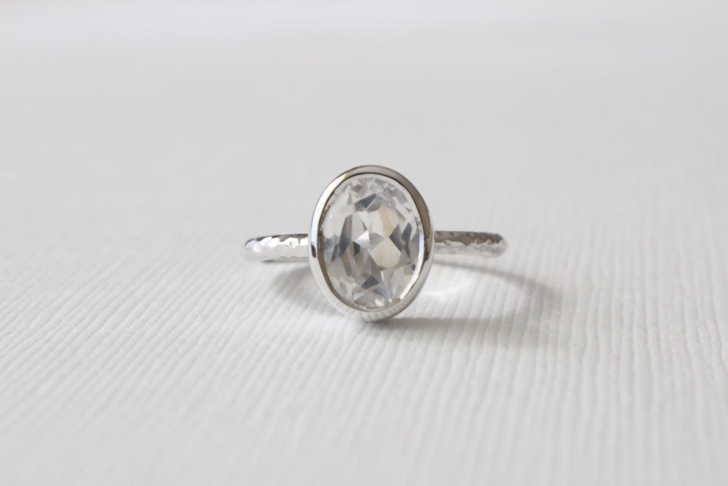 Oval Solitaire White Sapphire Bezel Ring in 14K White Gold