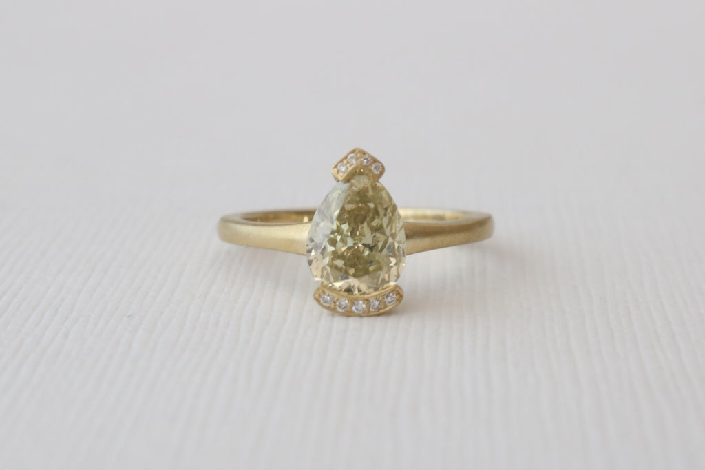 2.02 Carats Pear Cut Light Yellow Diamond Half Bezel Ring in 18K Yellow Gold