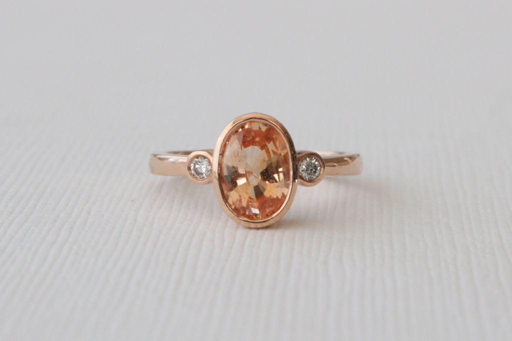 3 Stone Oval Peach Sapphire and Diamond Bezel Ring in 14K Rose Gold