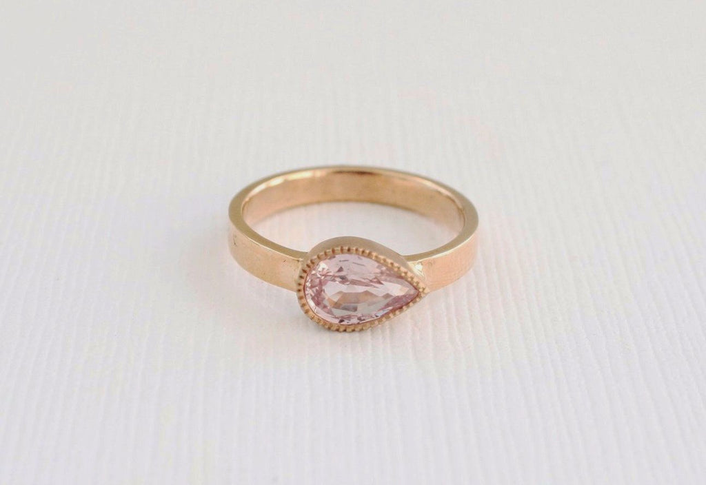 Pear Cut Peachy Pink Sapphire Milgrained Bezel Ring in 14K Rose Gold