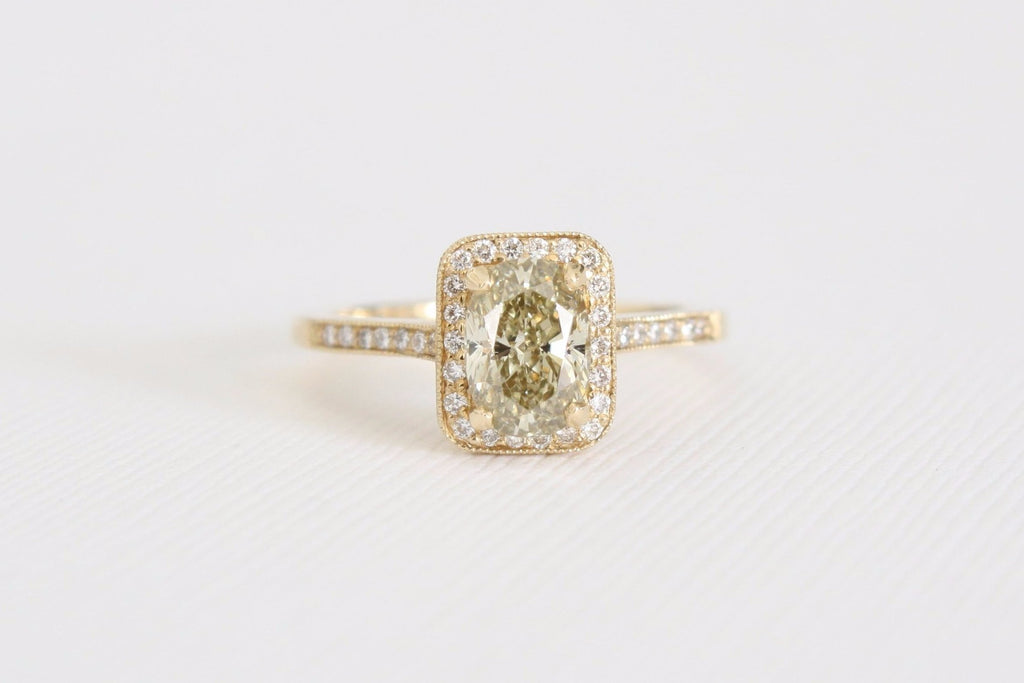 Oval Cut Yellow Champagne Diamond Halo Engagement Ring in 14K Yellow Gold