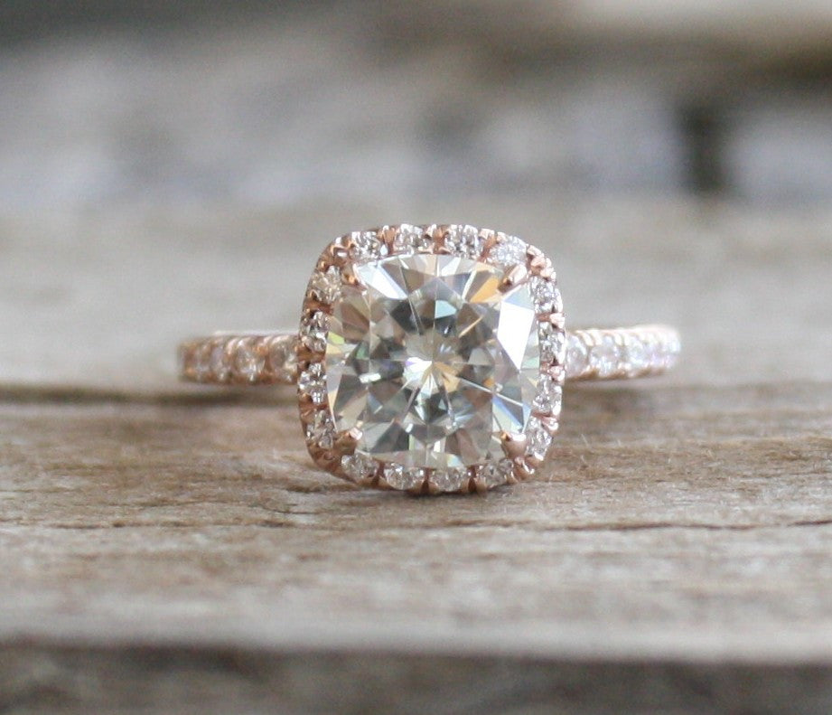 one gold rose and forever diamond jewellery halo ring under moissanite engagement