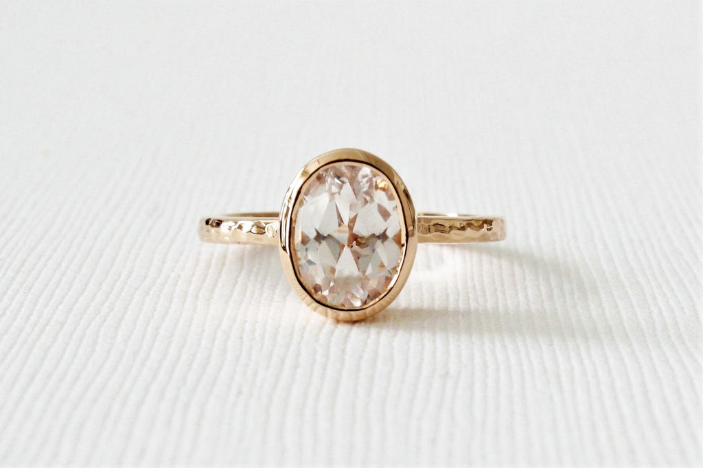 Oval Solitaire White Sapphire Bezel Ring in 14K Rose Gold
