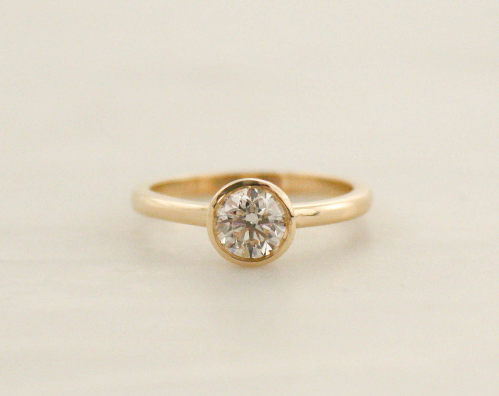 Simple Solitaire Diamond Engagement Ring in 14K Yellow Gold