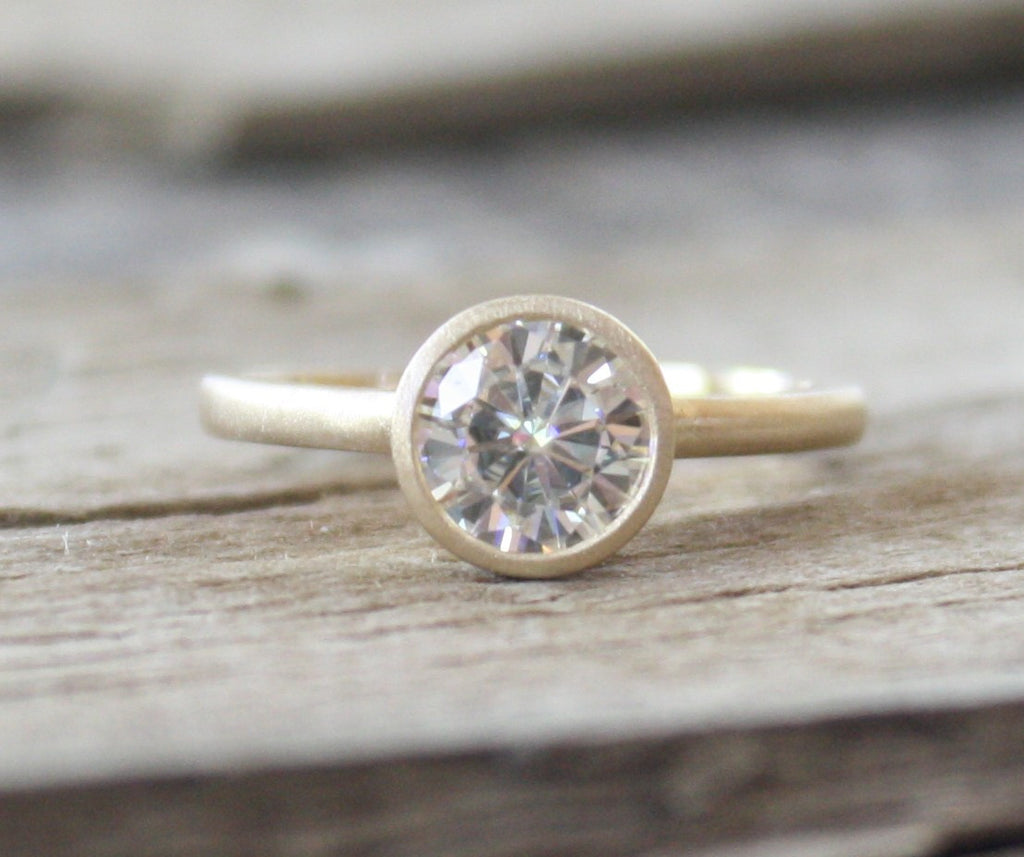7mm Forever Brilliant Moissanite Bezel Ring in 14K Yellow Gold