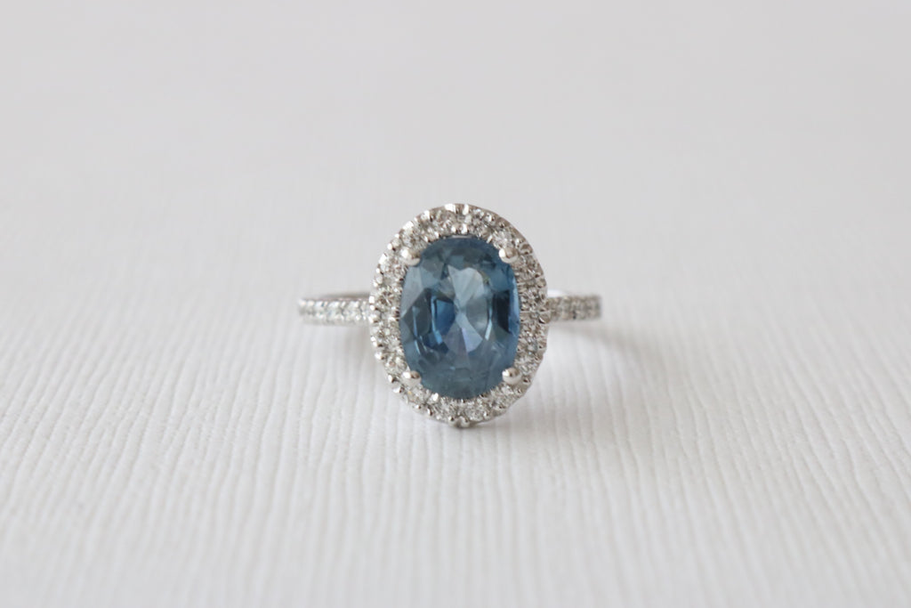 2.28 Cts. Oval Blue-Gray Sapphire Diamond Halo Engagement Ring in 14K White Gold