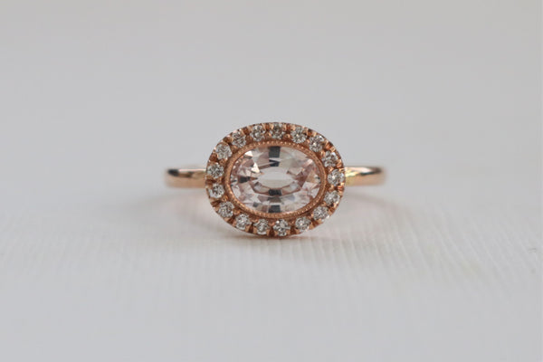 1.01 Ct. Oval Light Peach Sapphire Milgrain Bezel Halo Ring in 14K Rose Gold