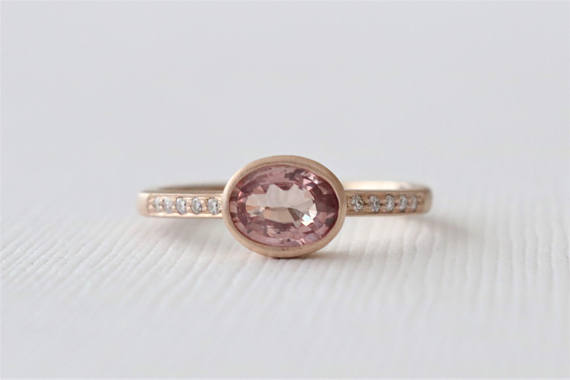 Oval Cranberry Peach Sapphire Bezel Diamond Ring in 14K Rose Gold