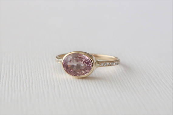 Oval Cranberry Pink Sapphire Bezel Diamond Ring in 14K Yellow Gold