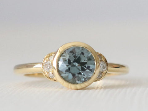 1.25 Cts. Round Montana Peacock Blue Sapphire Bezel Ring in 18K Yellow Gold