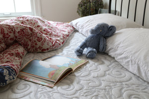 Elephant and book on memory foam mattress