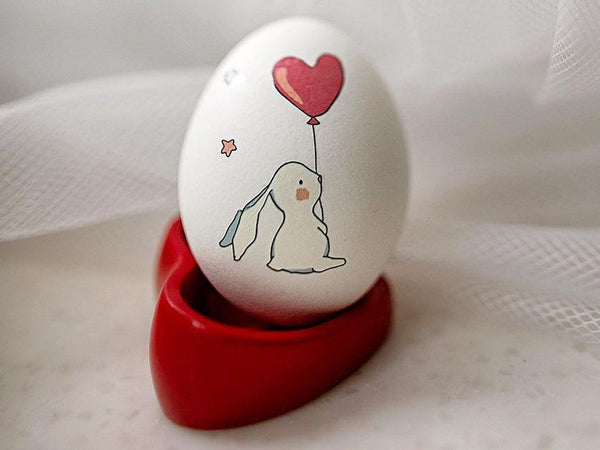Easter egg decorated with bunny temporary tattoo