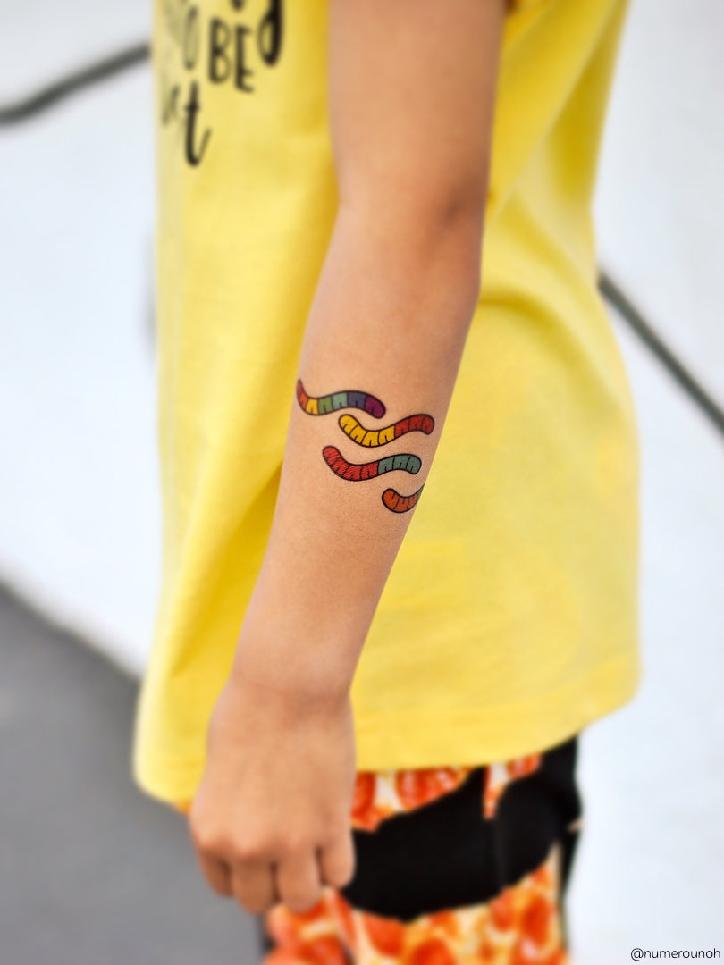 High quality temporary tattoos with 24 sweet and sour gummy worms. These yummy worms will be your favorite treat for sure! Made in collaboration with Thailand designer Chacha Ramnarong.