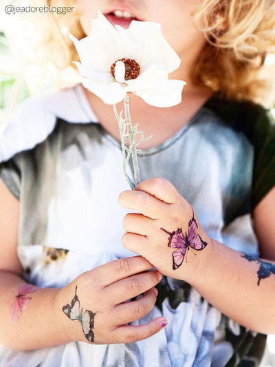 Children's wedding favors - romantic hand drawn butterflies temporary tattoos. Best kids table wedding ideas from Ducky street.