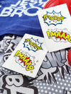 Comics temporary tattoos with Pooof and Baaam from Ducky street. Superheroes party bag supply.