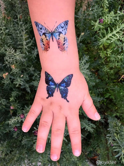 Beautiful shades of blue. Butterflies temporary tattoos for Girls birthday parties from Duckystreet.