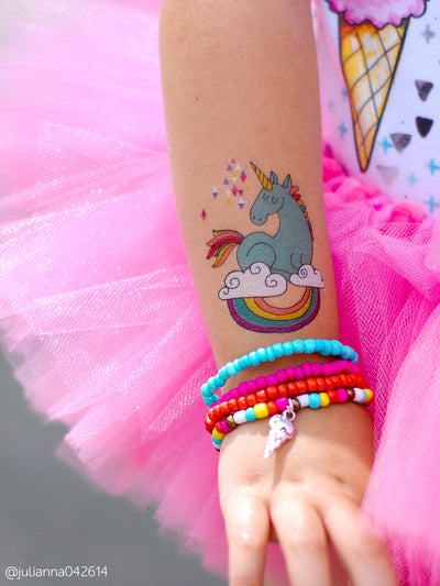"Temporary tattoo Unicorn on the cloud with rainbow. Unicorn girls birthday party supply. Let's make som magic! This kids fake tattoo is from Ducky street ""Unicorns"" tattoo collection."