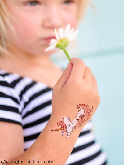 Unicorns and flower are the best for the little girls. Dreamy girl wearing white and pink unicorn temporary tattoo from Ducky street.