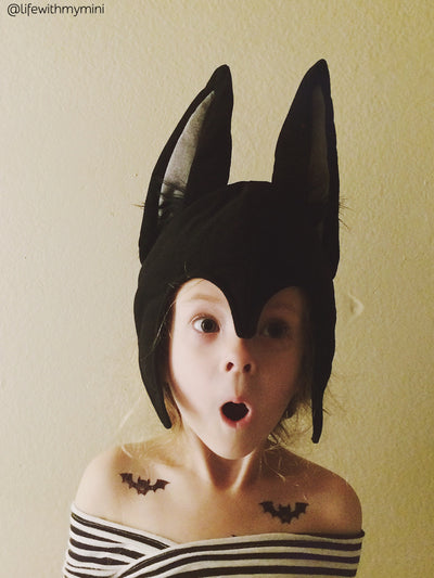 Bat Halloween costume with Bats temporary tattoos from Ducky street. Halloween party bag fillers.