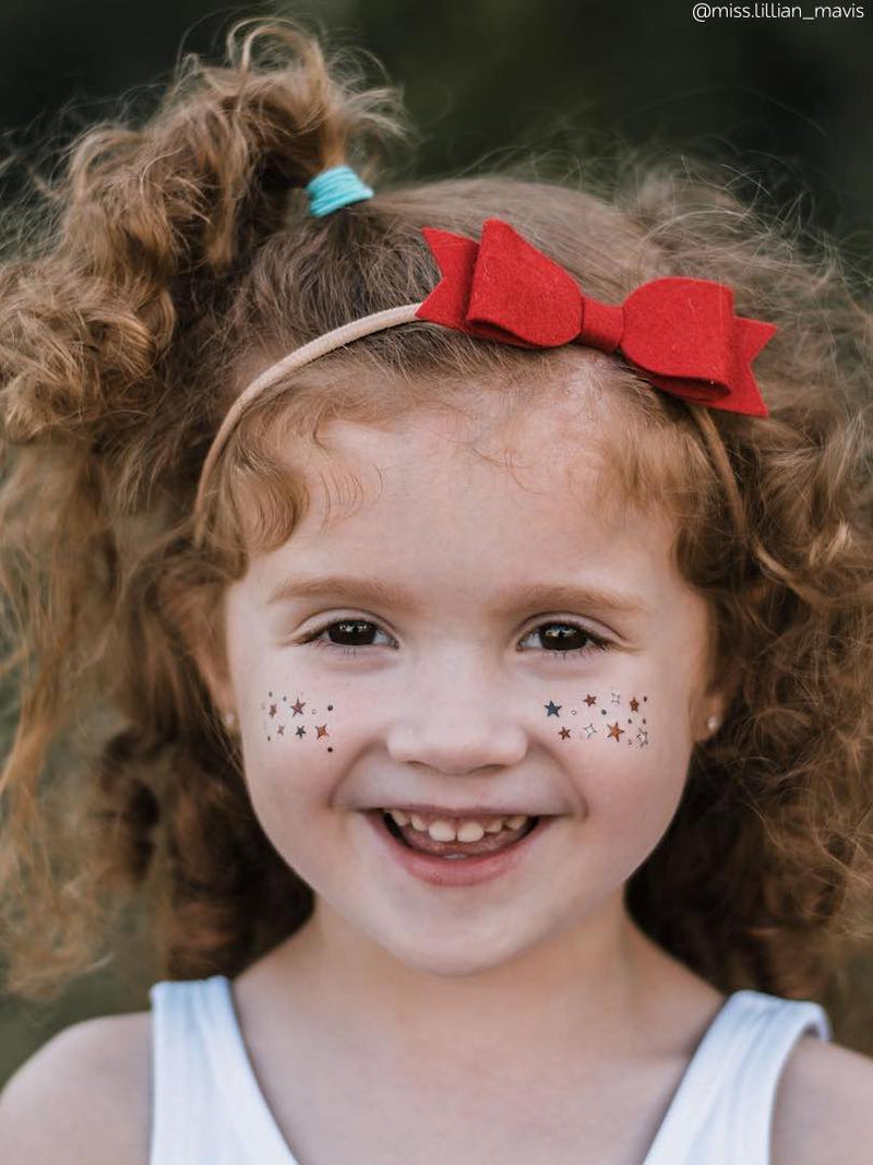 Temporary star freckles tattoos for kids in US flag colors. Patriotic 4th July look.