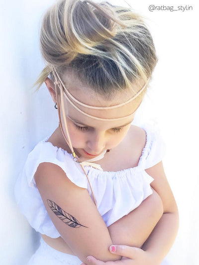 Black feather bohemian temporary tattoo for boho girls from Feathers and arrows big fake tattoos set. Great wedding children's table filler from Ducky street.