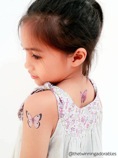 Pink butterfly temporary tattoo from Butterflies kids tattoo set of 21 watercolor butterflies.