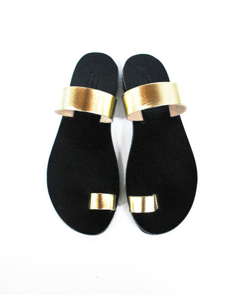 Black sole with gold straps