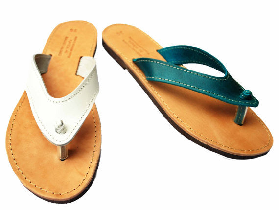 White and turquise flip flops with wide straps