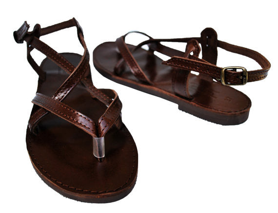 Dark brown sole sandals side view
