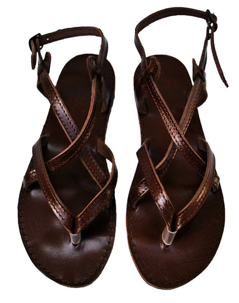 Dark brown sole sandals sky view