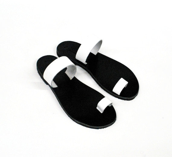 White straps on black leather toe rings