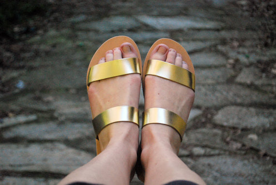 Clio slide sandals in gold color