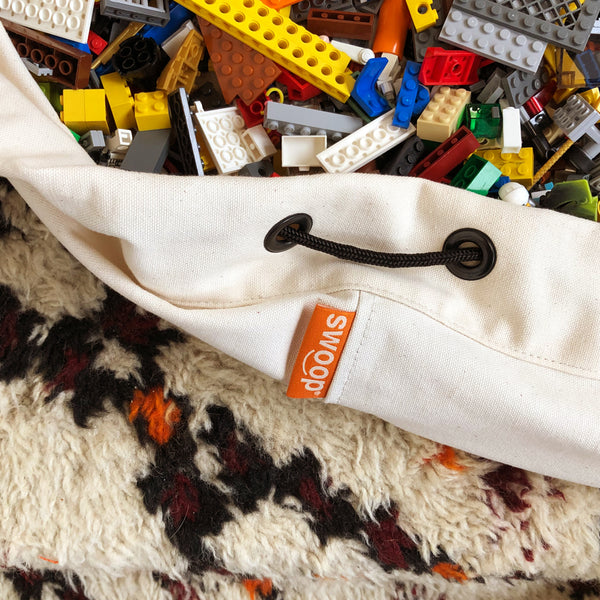detail of canvas swoop bag with legos