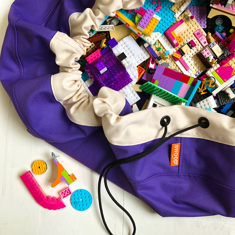 purple grape swoop bag opened with lego bricks